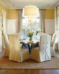 great way to disguise ugly chairs dining room chair slipcovers