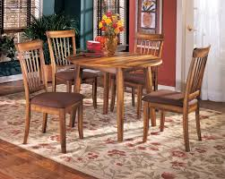 Berringer Round Dining Room Drop Leaf Table u0026 4 UPH Side Chairs by Ashley  Furniture Get your Berringer Round Dining Room Drop Leaf Table u0026 4 UPH  Side