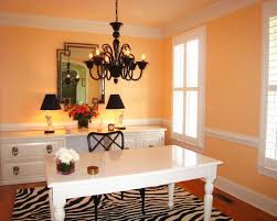 orange home office. transitional freestanding desk dark wood floor home office photo in miami with orange walls a