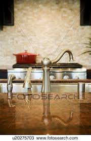 reflection of kitchen faucet on granite countertop