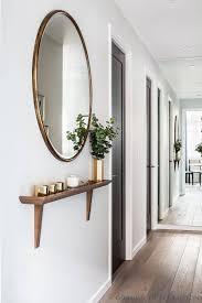 24. Full-Length Mirrored Hallway Illusion Wall