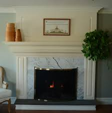 white marble for fireplace surround with ivory polished stone mantel and hanging green plant