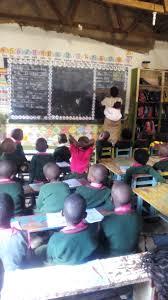 Nursery Teacher File Ugandan Nursery Teacher Jpg Wikimedia Commons