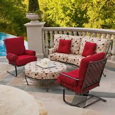 traditional iron chairs with cream flower pattern cushion and red with austin outdoor hammock chair patio real flame baltic