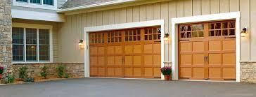 ideal garage doorCarriage House DoorsCustom Wood Garage Doors  Ideal Garage Doors