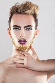 charming male model with makeup and multicolor beard studio shot grey background vertical