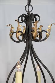 rococo wrought iron nine light iron chandelier with gold leaf acanthus leaf design for