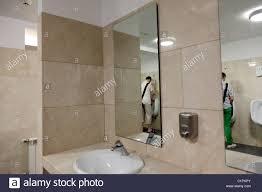 public bathroom mirror. Perfect Bathroom Male Public Toilet With Two People In The Mirror On Public Bathroom Mirror Y
