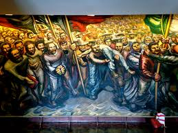 mural of workers carrying the of a fellow worker by david alfaro siqueiros