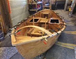 level decks started to actually get shaped and clamped and ed and epoxied onto the hull i d mess around by myself down in the with some piece