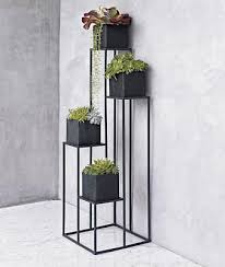 A Shaped Plant Stands: