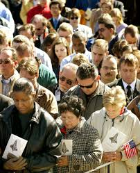th Anniversary of Space Shuttle Columbia Disaster Baltimore Sun s Darkroom NASA employees bow their heads in prayer at a memorial service February         for the seven astronauts killed in the space shuttle Columbia disaster