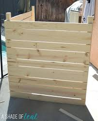 air conditioning unit covers outside wooden pallet fence covering