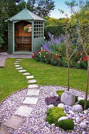 garden paths and stepping stones. lay square stepping stones over a grass and river rocks garden path. paths