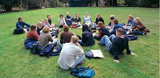 transfer student faqs admissions a large circle of students seated on the grass