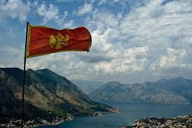 You'll see a lot of different colored crosses on either a red, white or blue field. Flag Of Montenegro Over Kotor Bay Montenegro Flag Tour Around The World Montenegro