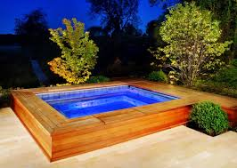 add a wood frame around an above ground pool to offer seating and places to put drinks and towels image platinum pool care collect this idea
