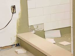 pitch all thresholds and half walls into the shower for drainage