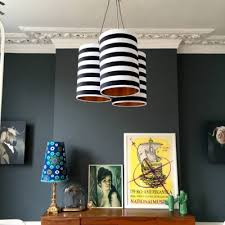 cer chandelier in circus stripes with metallic gold or copper lining