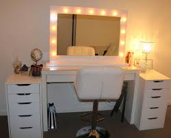 square mirror with lights on makeup vanity table with white chair and drawers