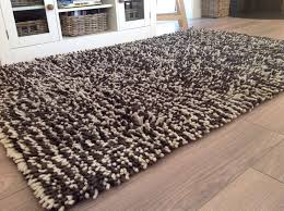 how to remove urine odor from wool rugs
