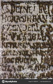 moss in letters form on old tombstone stock photo