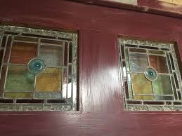 wooden front door with victorian stained glass panels