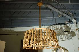 paul marra trellis chandelier shown in gold leaf and with eight light sputnik cer