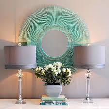 DIY Aquamarine Sunburst mirror. This is another idea about DIY mirrored  wall art. You