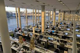 Norman foster office Foster Partners Inside Foster Partners Headquarters Everyone In The Studio Whatever Their Job Description Has Place At One Of The Long Workbenches The Arrangement Pinterest Office Tour Inside Foster Partners Headquarters Dream Office