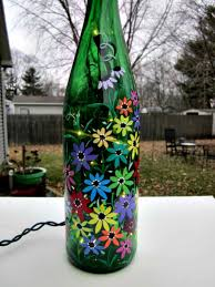 EMBELLISH your patio at night with a floral wine bottle lamp. how to paint  glass ...