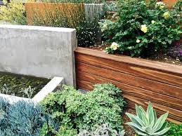 water feature concrete retaining wall wood succulents kier