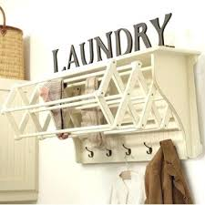fold up drying rack bathroom laundry area install a wall shelf attach a drying rack