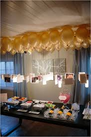 love this idea for a graduation party or special birthday . photos hanging  from balloons to create a chandelier over a party table.very fun party  decoration ...