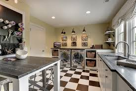 Truly inspirational: a laundry room and craft room join forces. Innovative  storage, unique lighting, and high-contrast details make this whimsical  laundry ...