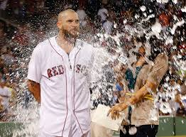 jonny gomes gutsy effort in left field indicative of red sox daniel nava gets soaked by teammates after the red sox 8 7 win over