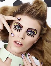 graphic eyes say o to the coolest eye makeup on the list we re definitely into the doll like nails too via keltie knight