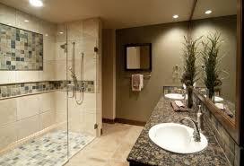 bathroom large glass shower stalls and beige tile wall connected by black granite bathroom vanity