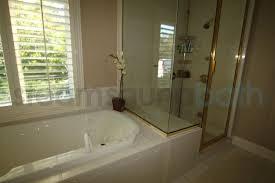 previous unique floor drains tub deck doubles as shower bench