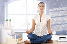 how to meditate in office. Pretty Girl Sitting On Top Of Desk In Bright Office, Meditating. Stock Photo - How To Meditate Office U