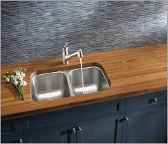 burmese teak wood countertop designed by blanco with a satchmo sticks bb blue gjgssbbb artistic