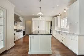 sink windows window u shaped kitchen with island layout granite countertop dining
