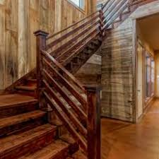 Rustic Stairs With Natural Wood Walls and Stained Wood Steps & Handrails