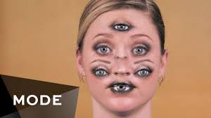 professional makeup artist demonstrates how to create a disconcerting face full of eyes
