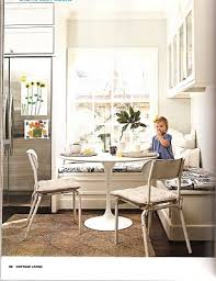 at michael j fox s home below a banquette in the kitchen is complemented by a teak dining table and knoll saarinen chairs the space is elegant