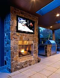 outdoor fireplace ideas with tv double sided fireplace with wall mounted television in the patio a outdoor fireplace ideas