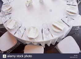 Round Table Settings For Weddings Classic Table Setting White Tablecloth Glasses Knife And