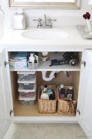 add a shelf that was cut out for pipes in the cabinet use storage space