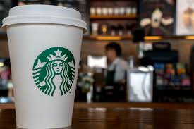 starbucks to offer drinks during the holidays fortune paper cup in a starbucks coffee shop