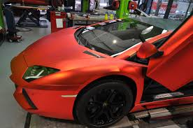 aventador matte red. matte is very much in fashion these days this orange red chrome shade looks perfect aventador